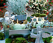 Advent arrangement Tin rain gutter with branches and candles