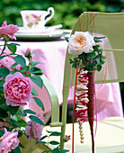 Decoration for coffee table: rose blossom and hedera