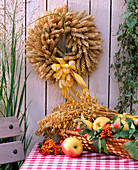 Wreath of wire with wheat eart, oats, apples and sorbus