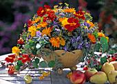 Bowl with bouquet, calendula (marigold), dill, borago