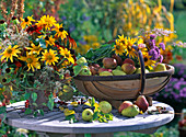 Bouquet with Rudbeckia 'Prairie Sun', 'Autumn Colors', Clematis fruits, Agera