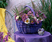 Basket of asters, callistephus, panicum