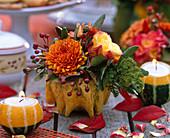 Pumpkins as flower vases and tealight holders, cucurbita, rose