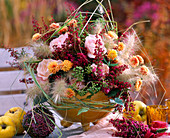 Arrangement of Erica, grasses, autumn chrysanthemums