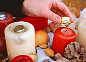 Wick from candles outdoors with water bottle stopper to protect from moisture