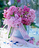 Hyacinthus orientalis (hyacinth) bouquet with a bow