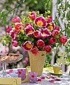 Tulipa (tulip), Euphorbia (spurge), yellow vase