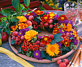 Table wreath of marigolds (calendula), berry jewelery