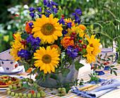 Helianthus (Sunflower), Delphinium (Larkspur)