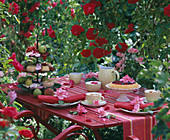 Coffee table with fruit cake, cake stand with biscuits