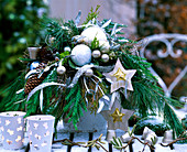 Advent arrangement with branches and tree decorations