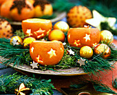 Citrus (orange), hollowed out and with candles