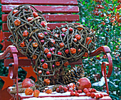 Heart of tendrils on a red chair