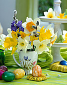 Easter table decoration, bouquet with narcissus