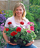 Young woman with freshly cooked geraniums
