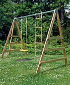Children swing in the lawn