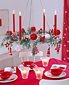 'Hanging Advent wreath; Metal wreath with red candles'