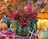 Cucurbita (pumpkin) as a vase, hollowed out, filled with bouquet