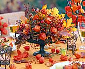 Autumn arrangement in footed iron vessel