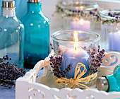 Glass decorated with lavandula, blue ball candle, white tray