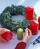 Advent wreath with ilex and apples