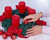 Nobilis wreath decorated in red