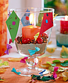 Rose, Malus, glass cup with sand, orange candle