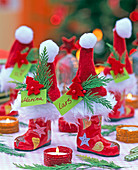 Colorful porcelain St. Nikolaus boots, decorated with red felt cap