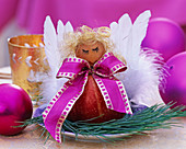 Malus, Pinus, angel figurine made of apple, wooden ball