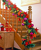 Garland of mixed green on stair rails
