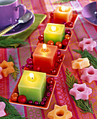 Modern Advent wreath with colorful candles