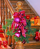 Nordmann fir branch with a pink tree decoration