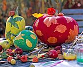 Paint pumpkins with leaf decor