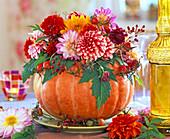 Dahlias and rosehips in pumpkin