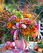 Autumn bouquet with dahlias and grasses