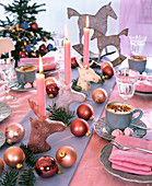 Christmas table decoration with moose heads as candlesticks