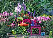 Summer flowerbed with phlox, Delphinium (larkspur), Crocosmia