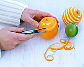 Carving patterns in oranges and limes