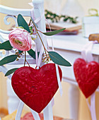 Blossom of ranunculus (ranunculus), eucalyptus and red tin heart
