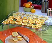 Orange and lemon slices drying, citrus, lemons behind