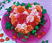 Dianthus (carnation) flowers in heart of Oasis on glass plate