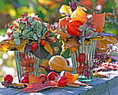 Bouquets of foliage, hydrangea, lanterns and rosehips