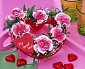 Oasis heart with pink and white carnations
