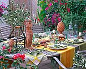 Table decoration with Olea (Olive), Rosmarinus (rosemary),