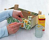 Fruit box with daffodils napkin deco