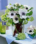 Bouquet of white anemone coronaria, viburnum