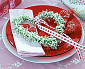 Heart-shaped gypsophila (gypsophila) wreath with decorative ribbon