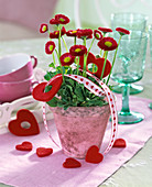 Bellis with red felt hearts and deco ribbon with heart motifs