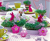 Easter table decoration with Lepidium in flat white cups