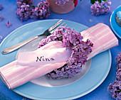 Napkin ring from Syringa vulgaris around pink striped napkin